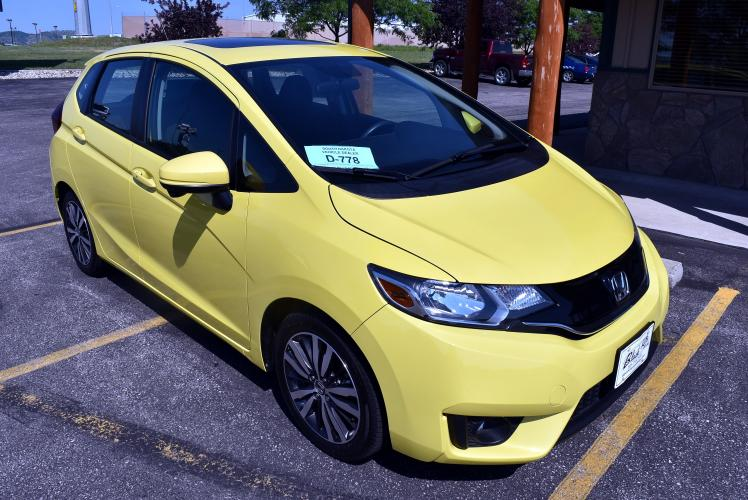 2015 Yellow Honda Fit EX (3HGGK5H89FM) with an 1.5L 4 Cyl engine, 1-Speed CVT with Overdrive transmission, located at 1600 E Hwy 44, Rapid City, SD, 57703, (605) 716-7878, 44.070232, -103.171410 - Photo #0