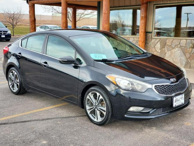 2015 Black Kia Forte EX (KNAFX4A80F5) with an 2.0L 4 Cyl engine, 6-Speed Automatic w/ Overdrive transmission, located at 1600 E Hwy 44, Rapid City, SD, 57703, (605) 716-7878, 44.070232, -103.171410 - Photo #0